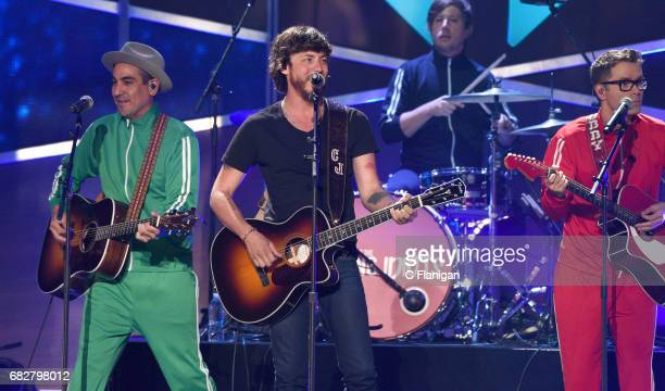 Singer Chris Janson performs onstage with Bobby Bones and the Raging Idiots during the 2017 iHeartCountry Festival A Music Experience by ATT at The...