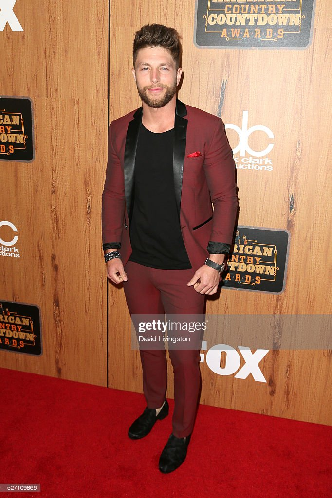 Singer Chris Lane poses in the press room at the 2016 American Country Countdown Awards at The Forum on May 01, 2016 in Inglewood, California.