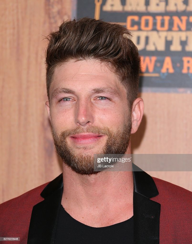 Singer Chris Lane poses in the press room during the 2016 American Country Countdown Awards at The Forum on May 1, 2016 in Inglewood, California.
