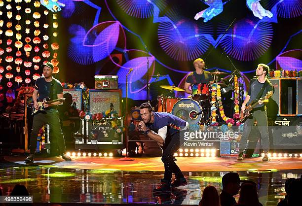 Singer Chris Martin and musicians Jonny Buckland Will Champion and Guy Berryman of Coldplay perform onstage during the 2015 American Music Awards at...