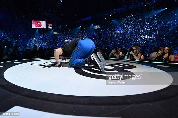 Singer Chris Martin of Coldplay performs onstage at the 2015 iHeartRadio Music Festival at MGM Grand Garden Arena on September 18 2015 in Las Vegas...