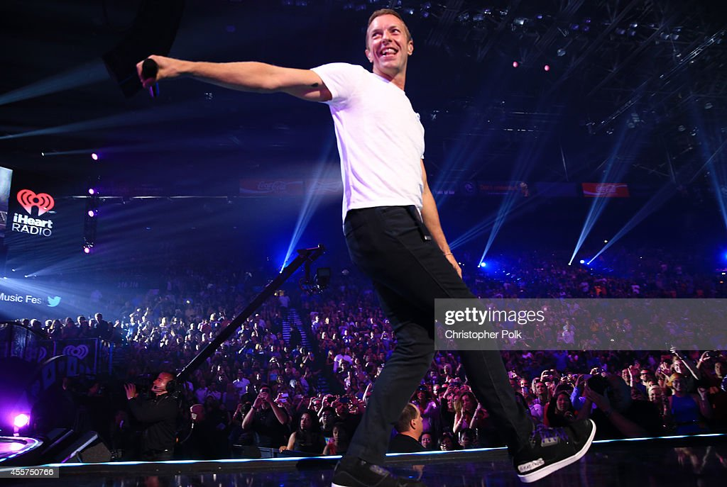 Singer Chris Martin of Coldplay performs onstage during the 2014 iHeartRadio Music Festival at the MGM Grand Garden Arena on September 19 2014 in Las...