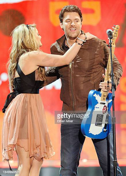 Singer Chris Young accepts the Breakthrough Single Award with Lauren Alaina onstage at the American Country Awards 2011 at the MGM Grand Garden Arena...