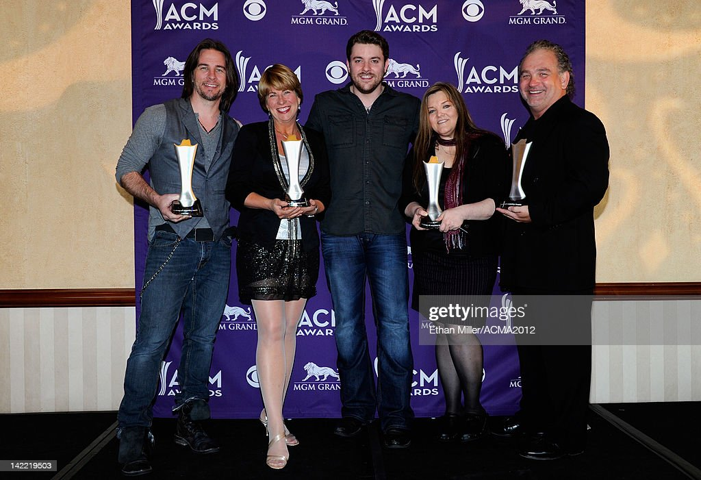 Singer Chris Young (C) and ACM Radio Station of the Year Winners pose onstage during ACM Radio Awards Reception at the MGM Grand Hotel/Casino on March 31, 2012 in Las Vegas, Nevada.