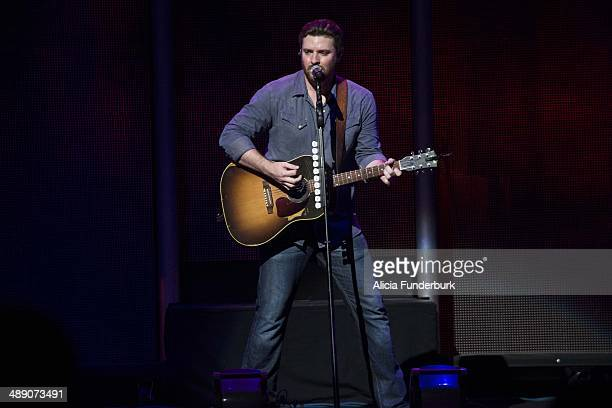 Singer Chris Young performs at PNC Music Pavilion during the Dierks Bentley concert on May 9 2014 in Charlotte North Carolina