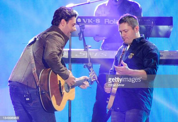 Singer Chris Young performs onstage at the American Country Awards 2011 at the MGM Grand Garden Arena on December 5 2011 in Las Vegas Nevada