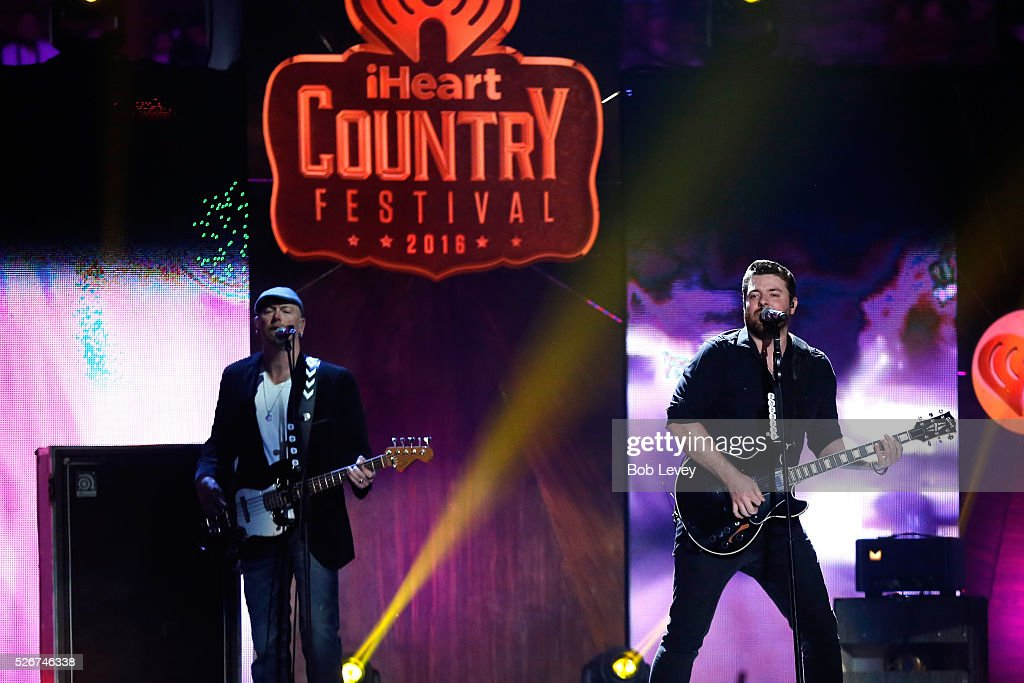 Singer Chris Young (R) performs onstage during the 2016 iHeartCountry Festival at The Frank Erwin Center on April 30, 2016 in Austin, Texas.