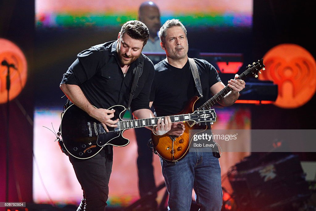 Singer Chris Young (L) performs onstage during the 2016 iHeartCountry Festival at The Frank Erwin Center on April 30, 2016 in Austin, Texas.