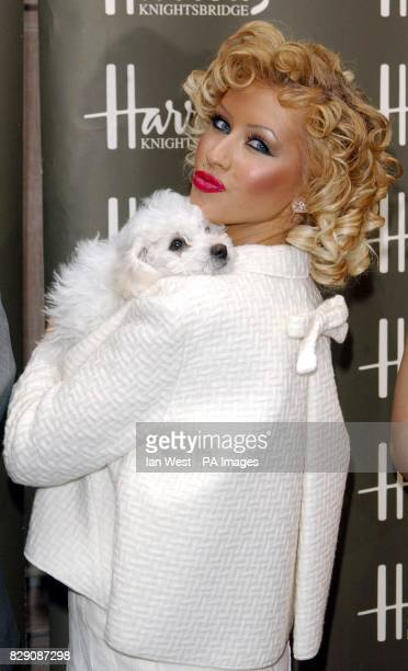 US singer Christina Aguilera and Bichon Frise Lucy officially open the Harrods Summer Sale at the worldfamous department store in Knightsbridge London