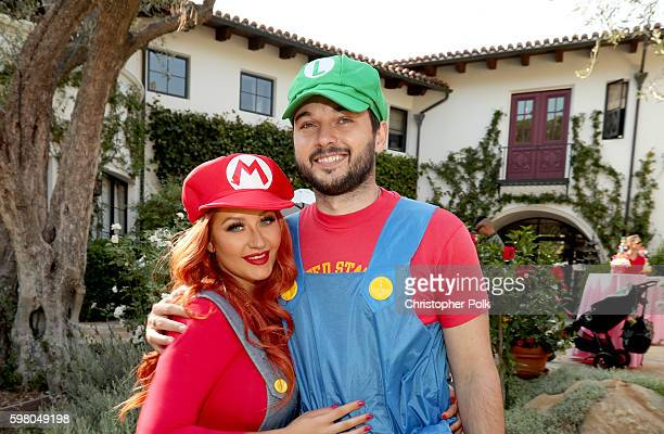 Singer Christina Aguilera and Matthew Rutler pose during the second birthday party for Christina Aguilera's daughter Summer Rain Rutler at a private...