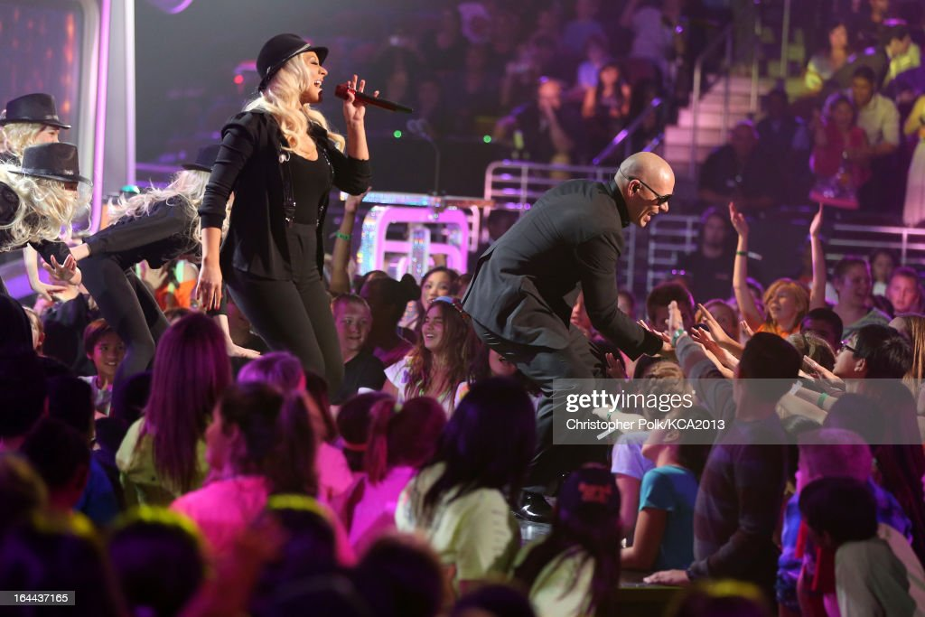 Singer <a gi-track='captionPersonalityLinkClicked' href=/galleries/search?phrase=Christina+Aguilera&family=editorial&specificpeople=171272 ng-click='$event.stopPropagation()'>Christina Aguilera</a> (L) and rapper Pitbull perform onstage during Nickelodeon's 26th Annual Kids' Choice Awards at USC Galen Center on March 23, 2013 in Los Angeles, California.
