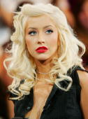 Singer Christina Aguilera appears on stage during MTV's Total Request Live at the MTV Times Square Studios June 21 2006 in New York City