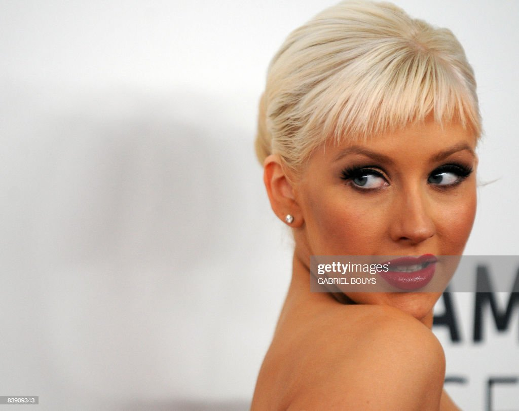 Singer <a gi-track='captionPersonalityLinkClicked' href=/galleries/search?phrase=Christina+Aguilera&family=editorial&specificpeople=171272 ng-click='$event.stopPropagation()'>Christina Aguilera</a> arrives at Nokia Theatre in downtown Los Angeles, December 3, 2008, to attend the announcement of nominations for the 51st Annual Grammy Awards.
