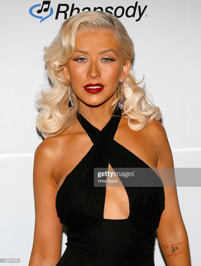 Singer <a gi-track='captionPersonalityLinkClicked' href=/galleries/search?phrase=Christina+Aguilera&family=editorial&specificpeople=171272 ng-click='$event.stopPropagation()'>Christina Aguilera</a> arrives at the Clive Davis pre-Grammy party held at the Beverly Hilton on February 10, 2007 in Beverly Hills, California.