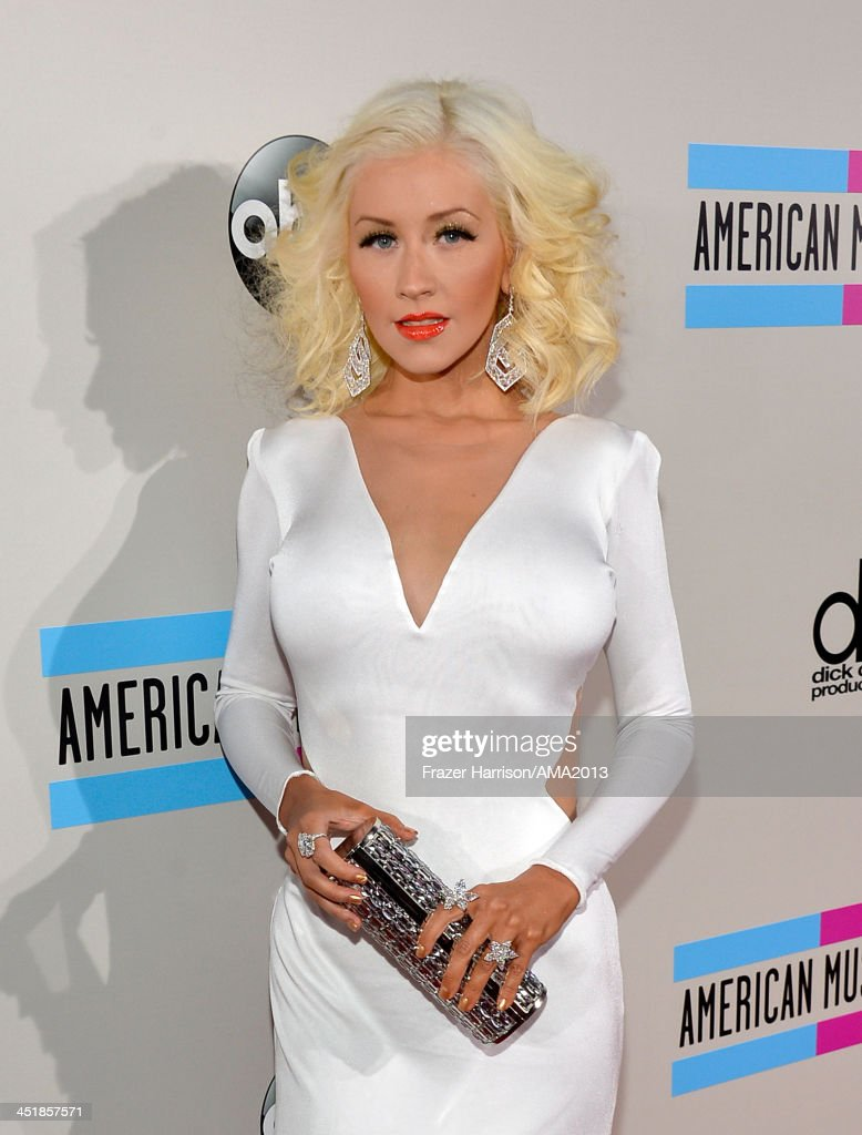 Singer <a gi-track='captionPersonalityLinkClicked' href=/galleries/search?phrase=Christina+Aguilera&family=editorial&specificpeople=171272 ng-click='$event.stopPropagation()'>Christina Aguilera</a> attends 2013 American Music Awards at Nokia Theatre L.A. Live on November 24, 2013 in Los Angeles, California.