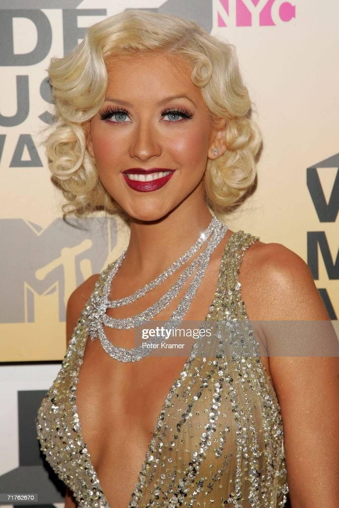Singer <a gi-track='captionPersonalityLinkClicked' href=/galleries/search?phrase=Christina+Aguilera&family=editorial&specificpeople=171272 ng-click='$event.stopPropagation()'>Christina Aguilera</a> attends the 2006 MTV Video Music Awards at Radio City Music Hall August 31, 2006 in New York City.
