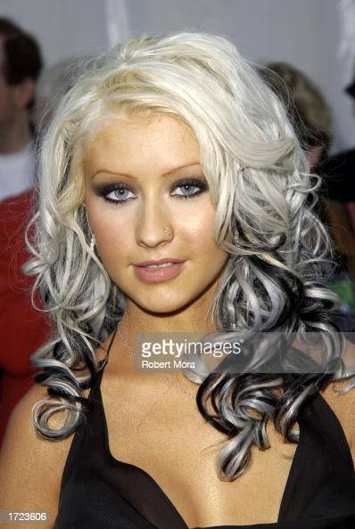 Singer Christina Aguilera attends the 30th Annual American Music Awards at the Shrine Auditorium on January 13 2003 in Los Angeles California