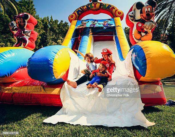 Singer Christina Aguilera her daughter Summer Rain Rutler and son Max Liron Bratman smile and laugh as they slide down the play slide during the...