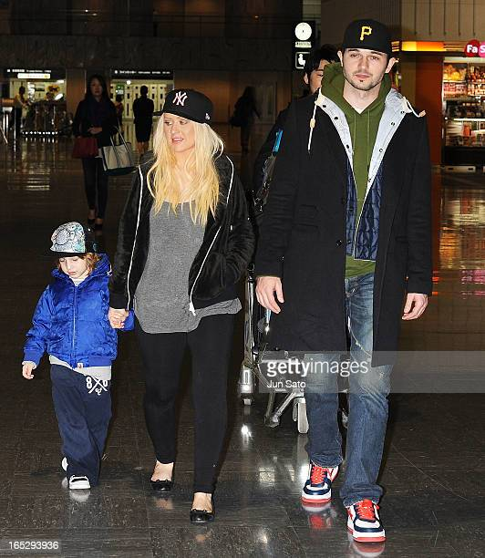 Singer Christina Aguilera Max Liron Bratman and Matt Rutler are seen at Narita International Airport on April 2 2013 in Narita Japan