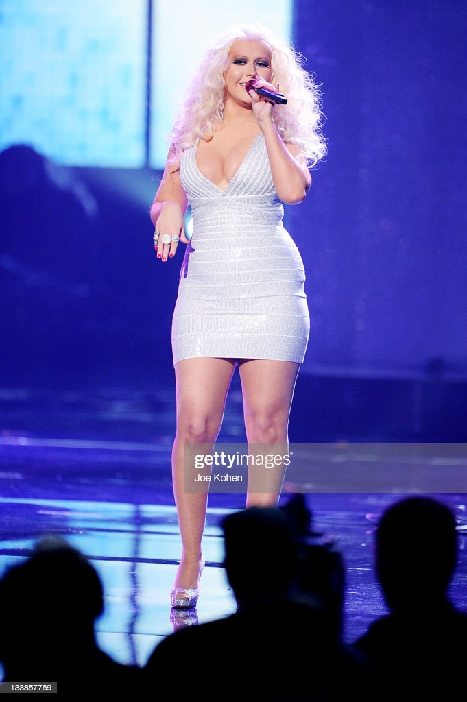 Singer <a gi-track='captionPersonalityLinkClicked' href=/galleries/search?phrase=Christina+Aguilera&family=editorial&specificpeople=171272 ng-click='$event.stopPropagation()'>Christina Aguilera</a> performs at the 2011 American Music Awards at Nokia Theatre L.A. Live on November 20, 2011 in Los Angeles, California.