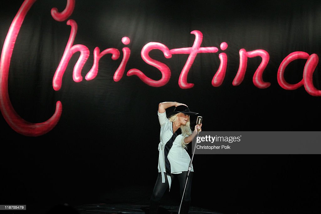 Singer <a gi-track='captionPersonalityLinkClicked' href=/galleries/search?phrase=Christina+Aguilera&family=editorial&specificpeople=171272 ng-click='$event.stopPropagation()'>Christina Aguilera</a> performs at the Maroon 5 Video Shoot for 'Moves Like Jagger' with <a gi-track='captionPersonalityLinkClicked' href=/galleries/search?phrase=Christina+Aguilera&family=editorial&specificpeople=171272 ng-click='$event.stopPropagation()'>Christina Aguilera</a> on July 8, 2011 in Los Angeles, California.