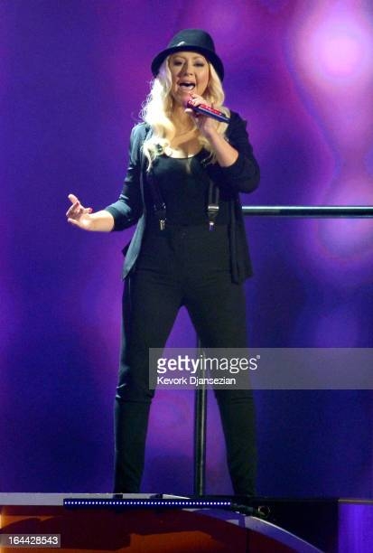 Singer Christina Aguilera performs onstage during Nickelodeon's 26th Annual Kids' Choice Awards at USC Galen Center on March 23 2013 in Los Angeles...