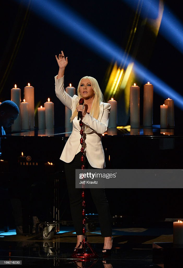 Singer <a gi-track='captionPersonalityLinkClicked' href=/galleries/search?phrase=Christina+Aguilera&family=editorial&specificpeople=171272 ng-click='$event.stopPropagation()'>Christina Aguilera</a> performs onstage during the 2013 People's Choice Awards at Nokia Theatre L.A. Live on January 9, 2013 in Los Angeles, California.