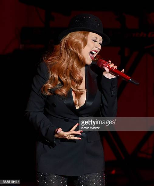 Singer Christina Aguilera performs onstage during the 'Hillary Clinton She's With Us' concert at The Greek Theatre on June 6 2016 in Los Angeles...