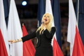 Singer Christina Aguilera sings the National Anthem during Super Bowl XLV between the Pittsburgh Steelers and the Green Bay Packers at Cowboys...