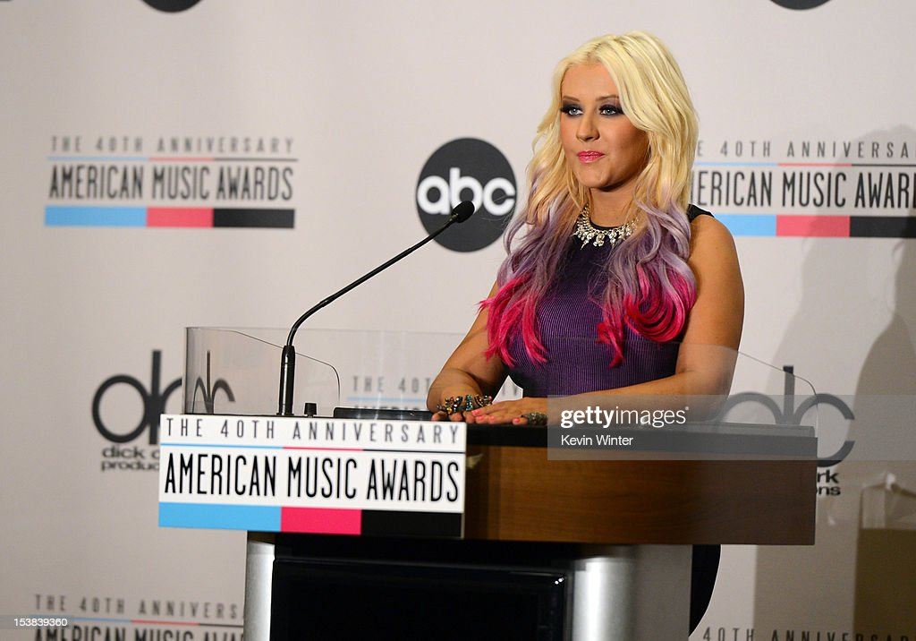 Singer Christina Aguilera speaks onstage during the 40th Anniversary American Music Awards nominations press conference at the JW Marriott Los Angeles at L.A. LIVE on October 9, 2012 in Los Angeles, California.