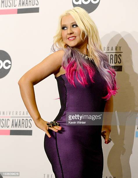 Singer Christina Aguilera speaks onstage during the 40th Anniversary American Music Awards nominations press conference at the JW Marriott Los...