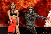 Singer Christina Milian and rapper Lil Wayne perform onstage at the 2014 American Music Awards at Nokia Theatre LA Live on November 23 2014 in Los...