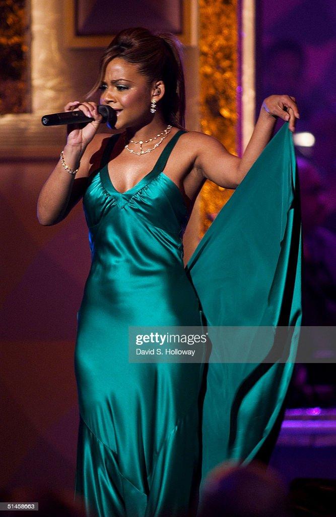 Singer Christina Milian performs at Black Entertainment Television's 10th Anniversary Walk of Fame celebration honoring Smokey Robinson on October 9, 2004 in Washington, DC.