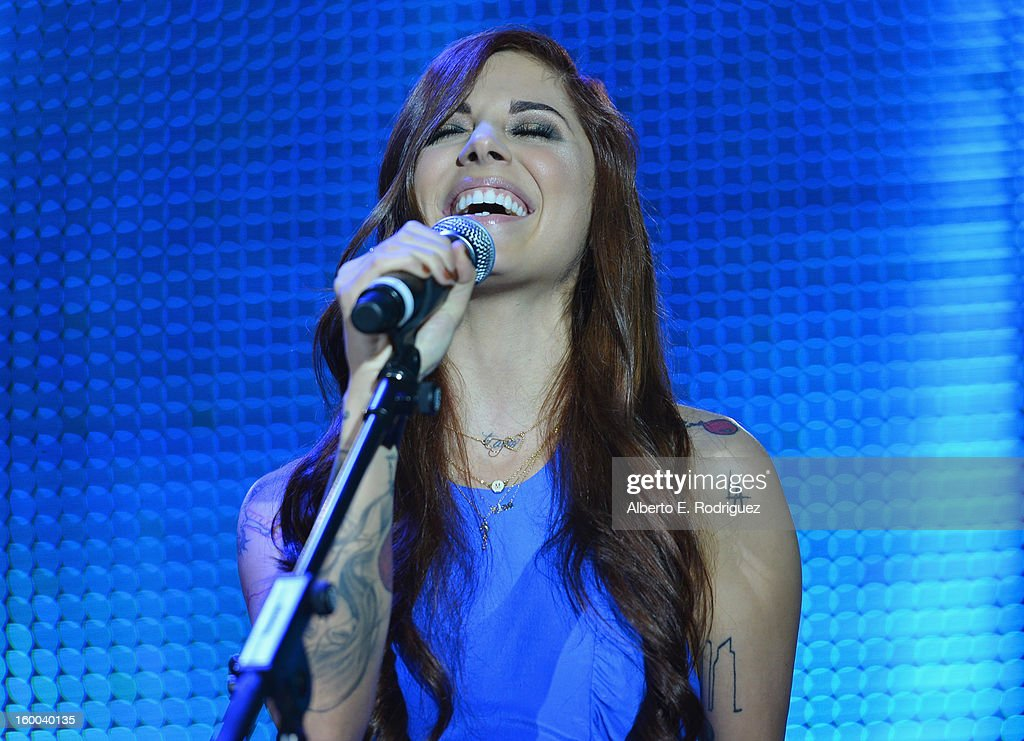 Singer Christina Perri performs at The Voice Health Institute's 'Raise Your Voice' benefit at the Beverly Hills Hotel on January 24, 2013 in Beverly Hills, California.