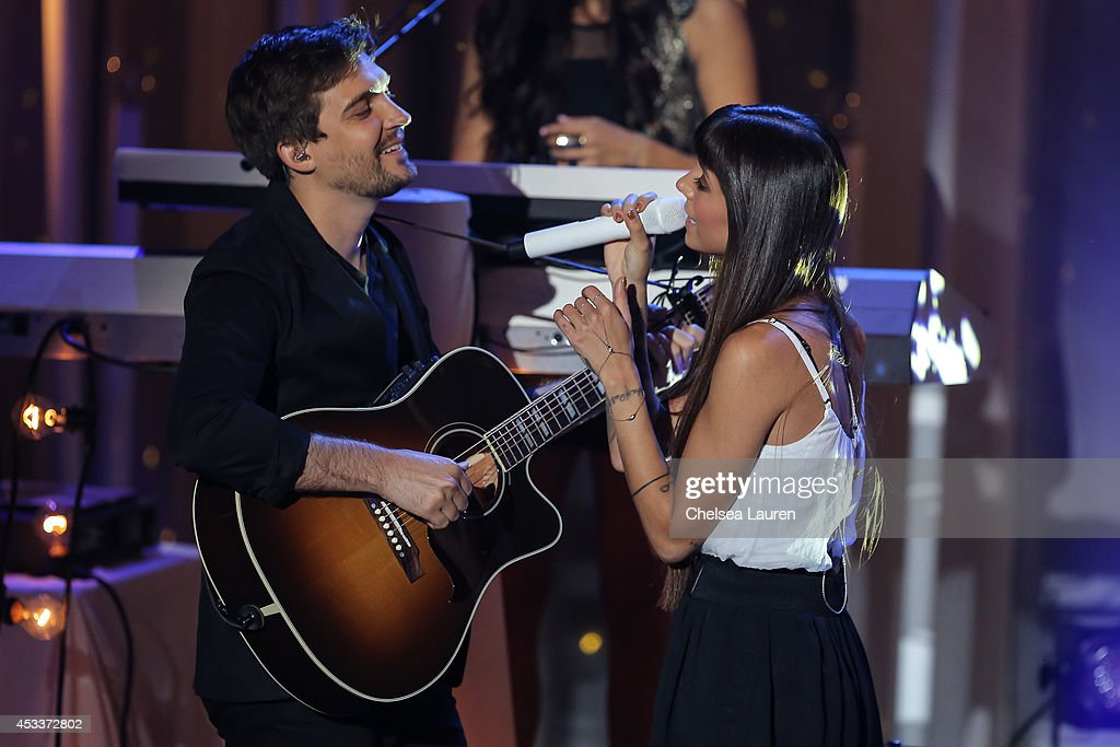 Singer Christina Perri (R) performs on the Honda Stage at the iHeartRadio Theater on August 8, 2014 in Burbank, California.