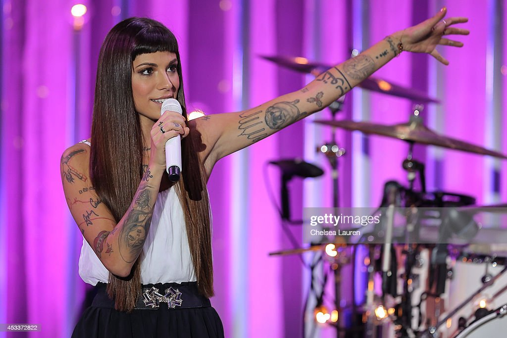 Singer Christina Perri performs on the Honda Stage at the iHeartRadio Theater on August 8, 2014 in Burbank, California.
