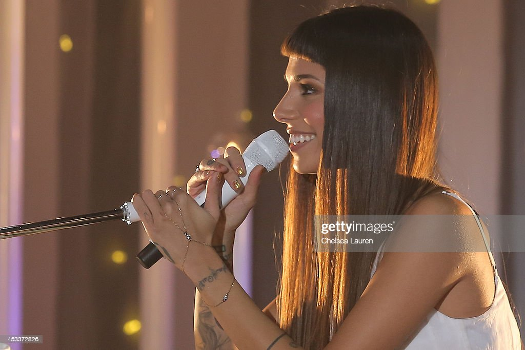 Singer <a gi-track='captionPersonalityLinkClicked' href=/galleries/search?phrase=Christina+Perri&family=editorial&specificpeople=7285432 ng-click='$event.stopPropagation()'>Christina Perri</a> performs on the Honda Stage at the iHeartRadio Theater on August 8, 2014 in Burbank, California.