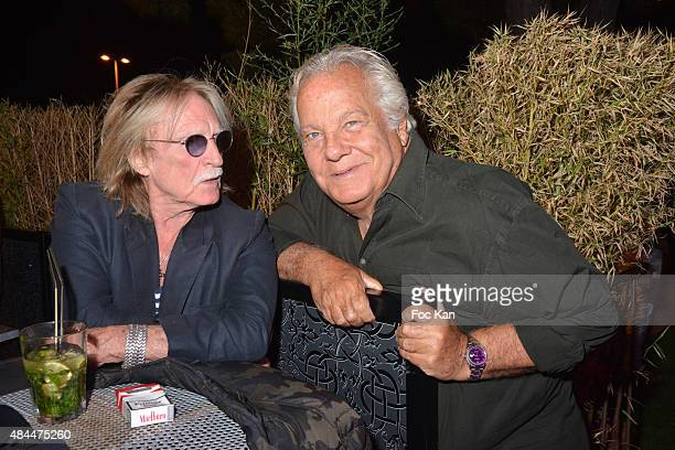 Singer Christophe and Massimo Gargia attend the Tsar Party at the Tsar Club in Saint Tropez on August 18 2015 in Saint Tropez France