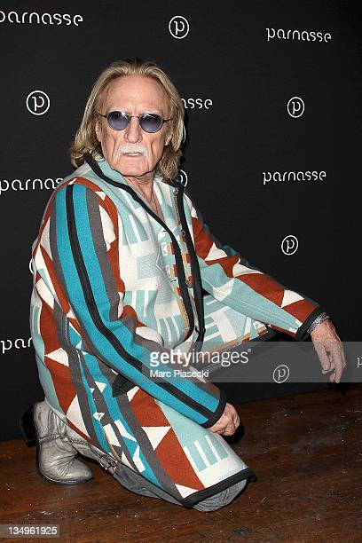 Singer Christophe attends the 'Louis Bertignac Private Concert Party Hosted by 'Parnasse' Orange VIP Club' photocall at 1515 Club on December 5 2011...