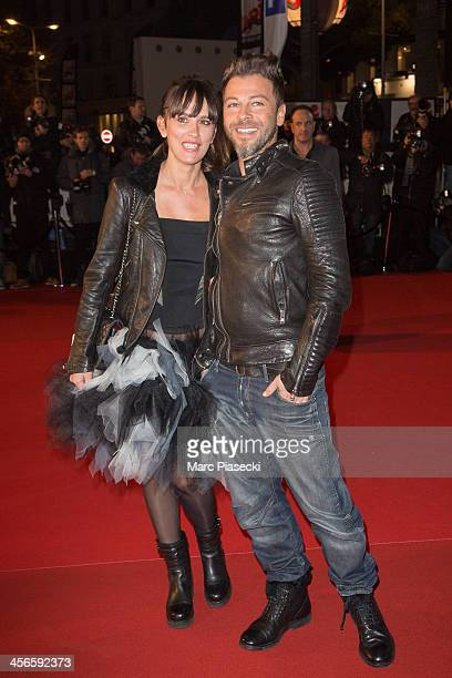 Singer Christophe Mae and wife Nadege Sarron attend the 15th NRJ Music Awards at Palais des Festivals on December 14 2013 in Cannes France