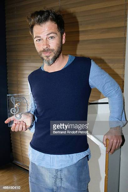 Singer Christophe Mae poses with his 'Song award' for the 'Tombe sous le Charme' during the 'Grands Prix de L'UNAC 2015' Award Ceremony at Sacem on...