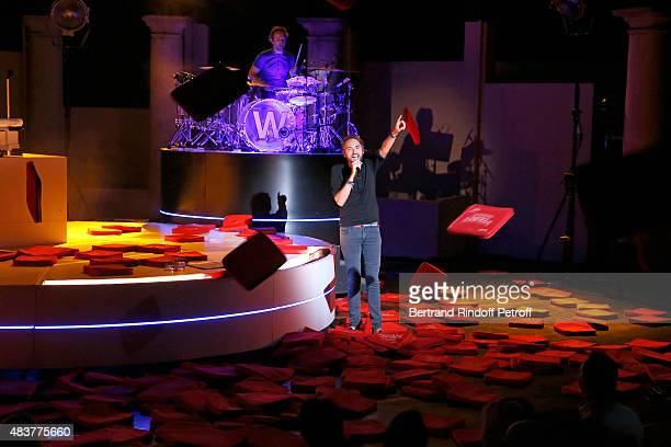 Singer Christophe Willem performs and acknowledges the applause of the audience whyle the traditional throw of cushions at the final of his...