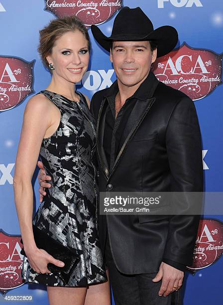 Singer Clay Walker and wife Jessica Craig arrive at the American Country Awards 2013 at the Mandalay Bay Events Center on December 10 2013 in Las...