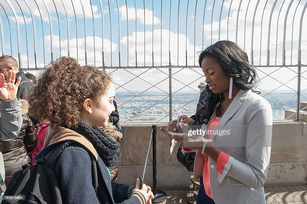 Singer Coco Jones (R) visits the 86th floor of The Empire State Building on March 13, 2013 in New York City.
