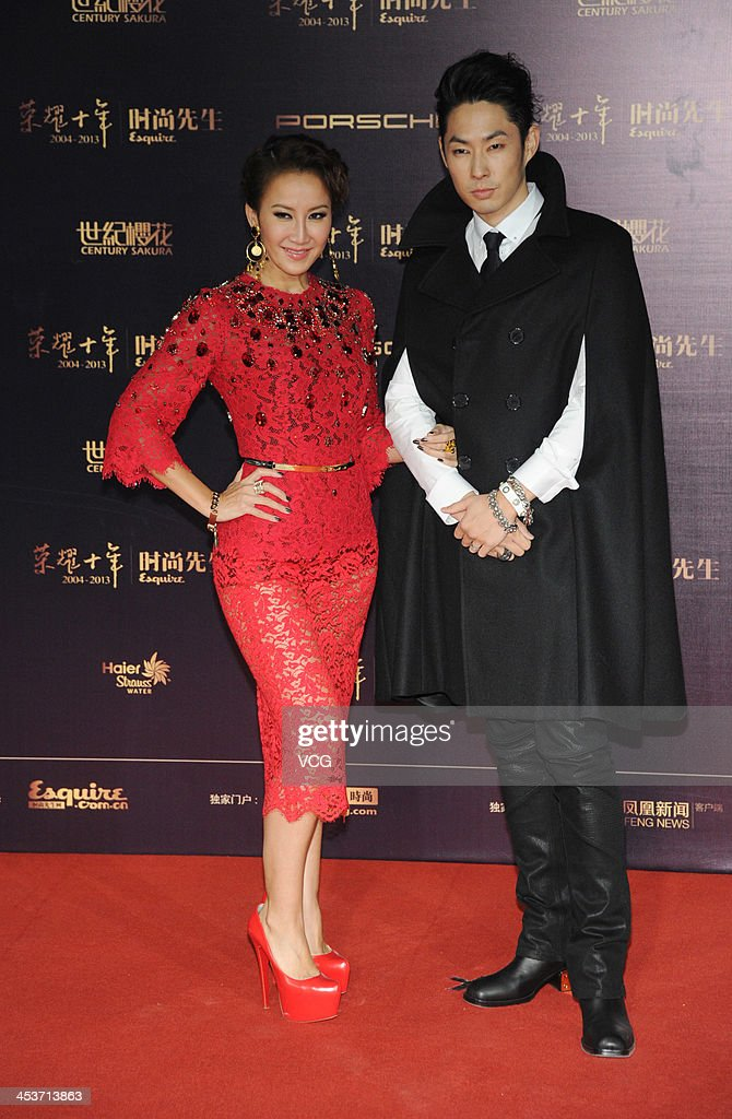 Singer CoCo Lee (L) and actor Vanness Wu (R) attend Esquire Men Of The Year Awards 2013 at Oriental Theatre on December 4, 2013 in Beijing, China.