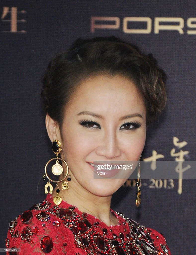 Singer CoCo Lee attends Esquire Men Of The Year Awards 2013 at Oriental Theatre on December 4, 2013 in Beijing, China.
