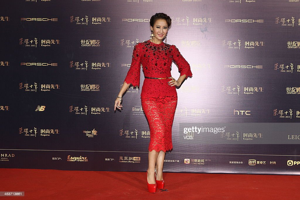 Singer <a gi-track='captionPersonalityLinkClicked' href=/galleries/search?phrase=CoCo+Lee&family=editorial&specificpeople=2081343 ng-click='$event.stopPropagation()'>CoCo Lee</a> attends Esquire Men Of The Year Awards 2013 at Oriental Theatre on December 4, 2013 in Beijing, China.