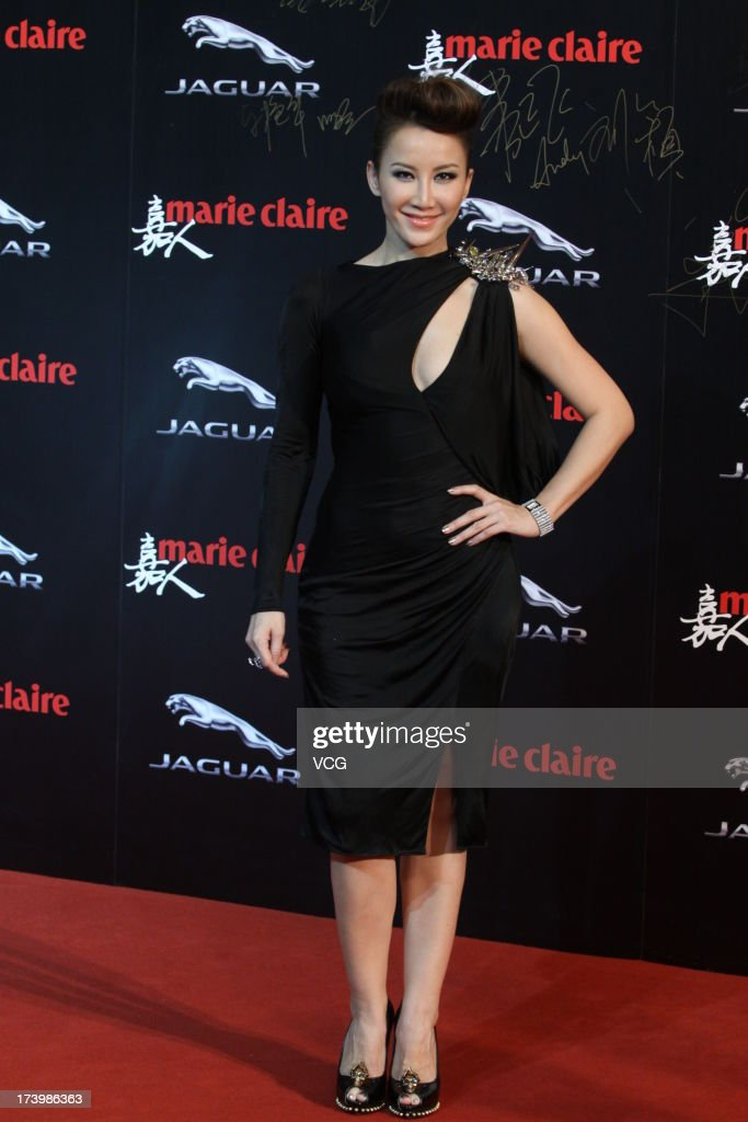 Singer <a gi-track='captionPersonalityLinkClicked' href=/galleries/search?phrase=CoCo+Lee&family=editorial&specificpeople=2081343 ng-click='$event.stopPropagation()'>CoCo Lee</a> attends Marie Claire Magazine Awards Ceremony at Shangri-La Hotel on July 18, 2013 in Shanghai, China.