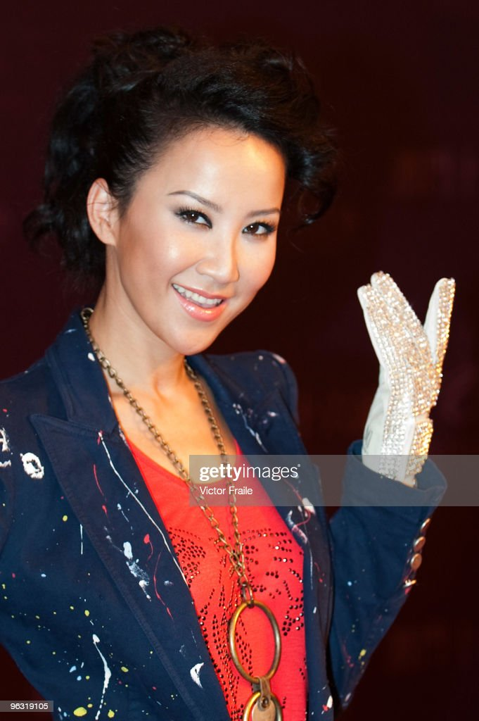 Singer Coco Lee poses for the media wearing a copy of the iconic white rhinestone glove worn by Michael Jackson during the opening ceremony of the MJ Gallery at Ponte 16 Resort-Macau on February 1, 2010 in Macau, China. Michael Jackson famously wore his white rhinestone glove at the 1983 Motown 25 Television Special, where he premiered the moonwalk to the world.