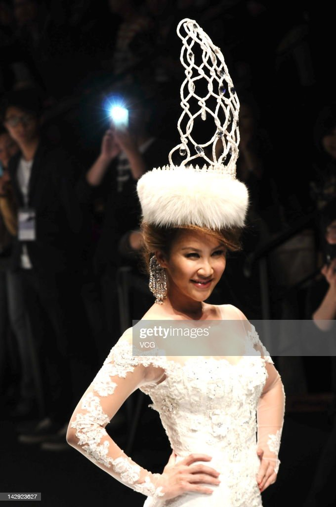 Singer Coco Lee showcases designs on the catwalk during the Dorain Ho collection show on the fourth day of 2012 A/W Shanghai Fashion Week at 800SHOW on April 14, 2012 in Shanghai, China.